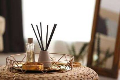 128306885-composition-with-stylish-accessories-and-interior-elements-on-wicker-pouf-indoors